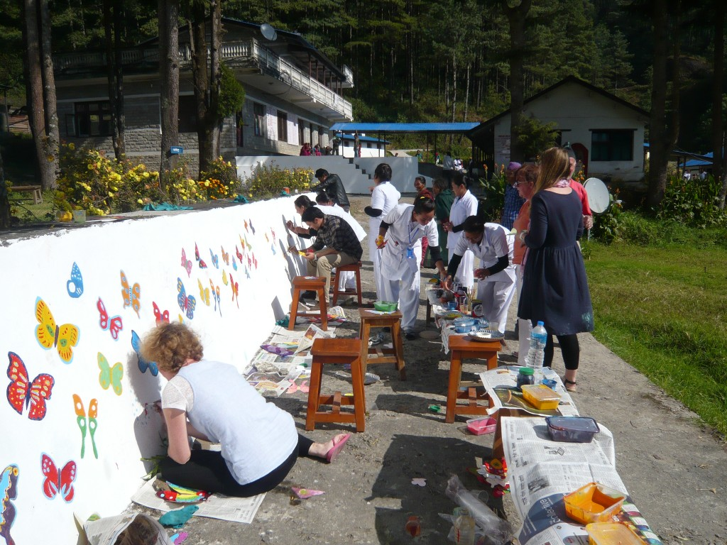 Nurses join to paint mural